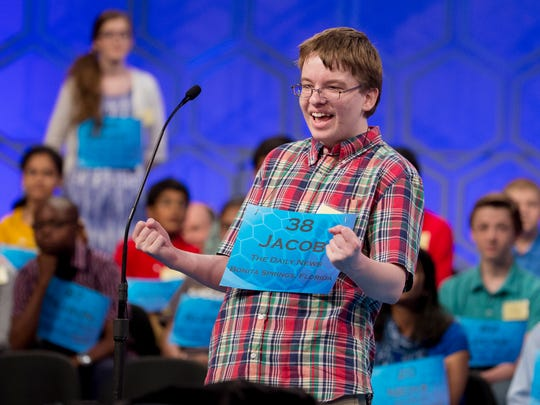 "Home-schooled student Jacob Williamson, 15, of Cape Coral, pumps his fists after hearing his word, ""euripus,"" during the 2014 semifinals of the Scripps National Spelling Bee."