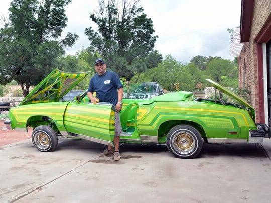"Jesse Paredes, a member of Good Times Car Club, and his 1979 Oldsmobile Cutlass Supreme, which he fondly named ""Ambitions."" The car will be on display at the Dale Gas! car show on Friday,  June 22."