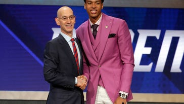 The Latest: Bow ties, international picks dominate NBA draft