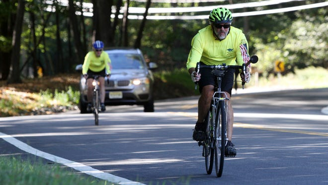 Eric Brenner of Silver Springs, MD, right, and Cyndi Steiner of Montclair, cycle along West Hanover Avenue as part of the 9/11 National Memorial Trail ride, Sunday, September 20, 2015, in Parsippany, NJ.