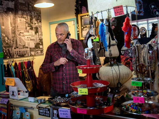Metro Retro owner Ted Stewart takes a phone call at