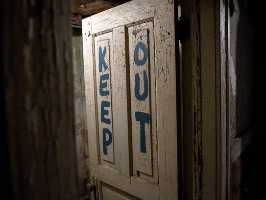 A sign on a door in the basement of the old Stimson