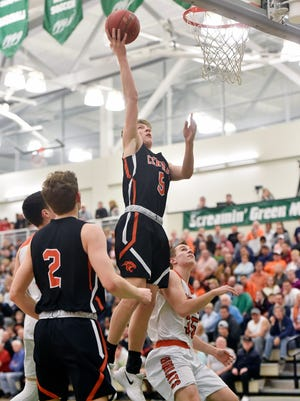 Central York's Braden Richard shoots against Northeastern in the first half of the boys' YAIAA basketball championship game Thursday, Feb. 15, 2018, at Grumbacher Sport and Fitness Center. Northeastern defeated Central York 65-62 to defend the Bobcats' 2017 YAIAA title win.