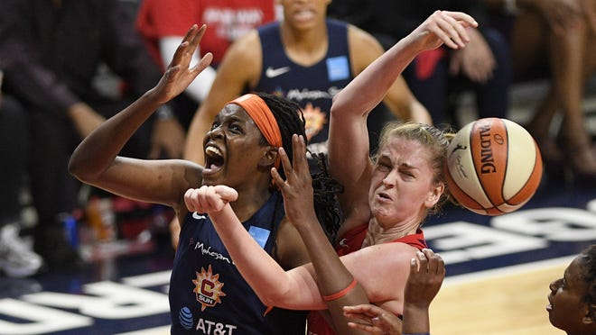 Connecticut Sun forward Jonquel Jones, left, battles for the ball against Washington Mystics center Emma Meesseman, right, in the second half of Game 5 of basketball's WNBA Finals last season in Washington.