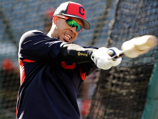 FILE - In this Oct. 3, 2017, file photo, Cleveland Indians' Michael Brantley warms up before batting practice during a workout in Cleveland. Brantley has progressed to lateral agility drills as he works his way back from right ankle surgery in October with an eye toward playing as much as possible this season. (AP Photo/Tony Dejak, File)