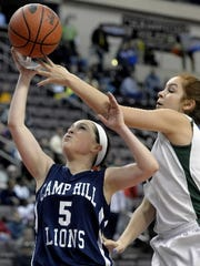 Kate Bauhof (right) and the Fighting Irish will try to win an 11th straight district title Thursday against Camp Hill.