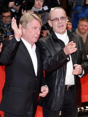 FILE - In this file photo dated Friday, Feb. 8, 2013, showing Francis Rossi, right, and Rick Parfitt as they arrive for the screening of the film Promised Land at the 63rd edition of the Berlinale, International Film Festival in Berlin, Germany. Status Quo rock band guitarist Rick Parfitt has died in Spain at age 68, according to a statement released by his manager Simon Porter, Saturday Dec. 24, 2016.