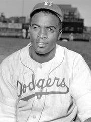 FILE - This is an April 18, 1948, portrait of Brooklyn Dodgers baseball player Jackie Robinson. The first statue in Dodger Stadium history belongs to Jackie Robinson. The team will unveil his likeness during Jackie Robinson Day festivities on Saturday, April 15, 2017, with his wife and extended family in attendance on the 70th anniversary of him breaking baseball's color barrier.
