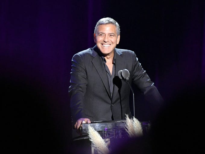 Host George Clooney speaks during the Motion Picture