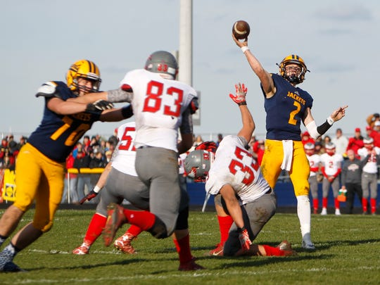 Yellowjackets QB Joey Bentley throws against Frankenmuth Saturday, Nov. 12, 2016, at Ithaca.  Ithaca lost 28-20 for the time on their home field since 2009 and it was just the program's second loss since the start of the 2010 season.
