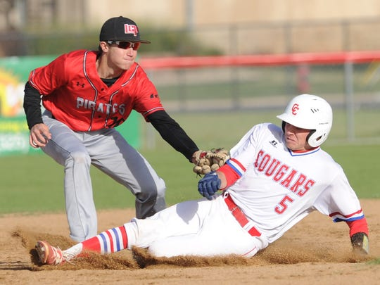 Lubbock Cooper second baseman Austin Voight tags out Abilene Cooper's Andrew Benson, who was trying to steal second base with two outs in the fifth inning, The Cougars beat Lubbock Cooper 4-1 in the District 4-5A game Saturday, April 18, 2018 at Cougar Field.