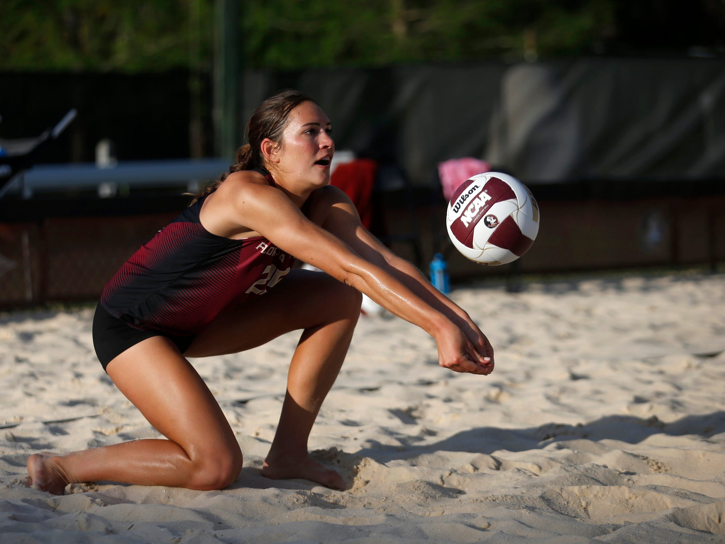 FSU's Victoria Paranagua bumps the ball during their match against the College of Charleston in the final round of the Seminoles' hosted beach volleyball invitational on Saturday, April 16, 2016.