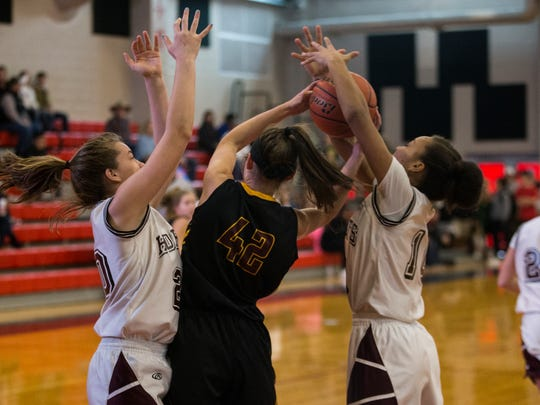 Flour Bluff's Gloria Geurin and Hayle Campbell steal the ball from Dripping Springs' Shelbye Hartman during the annual Roy Williams Holiday Tournament Thursday, Dec. 28, 2017, at West Oso High School.