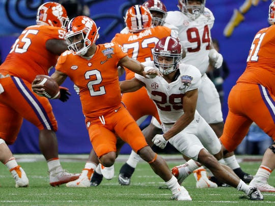 Clemson quarterback Kelly Bryant tries to scramble away from Alabama defensive back Minkah Fitzpatrick during the second quarter of the 2018 Sugar Bowl.