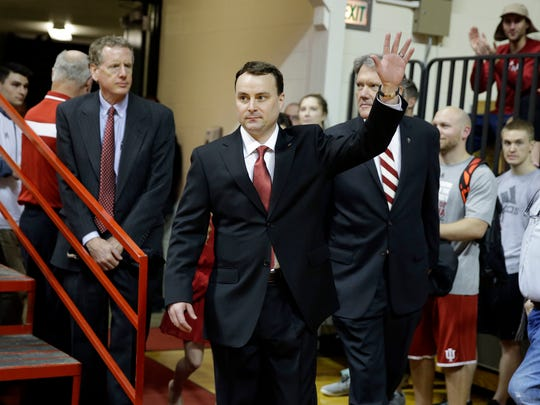 New Indiana coach Archie Miller waves as he walks on to the court of Assembly Hall before he was introduced during a news conference on the court in Bloomington, Ind., Monday.