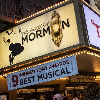 """A marquee for """"The Book of Mormon"""" is shown last spring in New York City."""