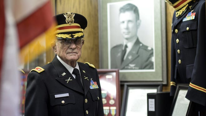 In this photo taken Oct. 25, 2015, Charles Kettles poses for a photo  at the Ypsilanti Historical Museum in Ypsilanti, Mich. Kettles, a Vietnam War helicopter pilot, will receive the Medal of Honor from President Barack Obama at a White House ceremony on July 18, for saving the lives of dozens of troops.