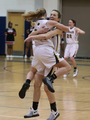 Honeoye Falls-Lima's Maddy Meehan, left, jumps into the arms of teammate Taryn Wilson as they celebrate at the buzzer after beating Wilson 60-55 to win their Section V Class A2 final Friday, March 3, 2017 at Eastridge High in Irondequoit.