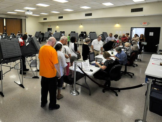 People line up to vote early at the Madison County Agricultural Complex Auditorium in Jackson, Tenn., on Wednesday, Oct. 19, 2016.