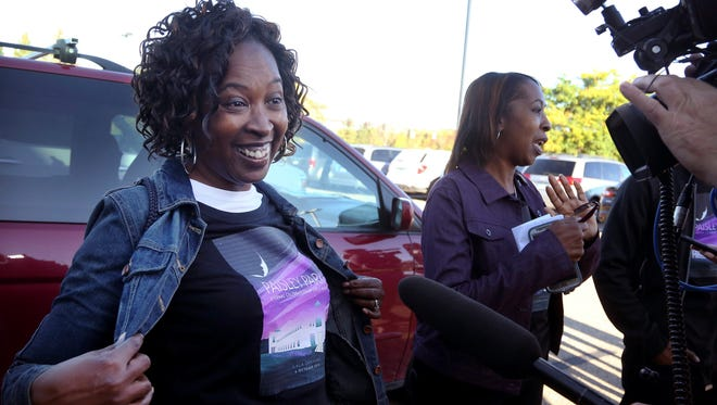 Prince fan Gloria Brown, from Chicago,  shows off her custom made Paisley Park t-shirt as she waits to get inside the new Paisley Park Tour with her sister Yvonne Brown, right,  Thursday, Oct. 6, 2016, in Chanhassen, Minn.  Prince's handwritten notes still sit out in Studio A where he recorded some of his greatest hits. The studio is filled with keyboards and guitars. Those are some of the highlights visitors will see when Paisley Park opens for public tours Thursday. It's where Prince lived, and it's where he died of an accidental painkiller overdose in April.
