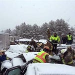 In this photo provided by Maine State Police And Maine Emergency Management, emergency personnel respond to a multi vehicle pileup on Interstate 95 near Bangor, Maine, Wednesday.  State police spokesman Steve McCausland says the pileup in Etna happened early Wednesday in heavy snow and involved many cars, a school bus and a tractor trailer. No fatalities were immediately reported but McCausland says some of the injuries were serious.