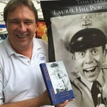 "In this undated photo, historian Tom Perry shows off the new book he co-authored with David Browning, ""My Life as The Mayberry Deputy: We Have Extra Security Tonight!"" at a recent festival in Wytheville, Va. The book is Browning's autobiography, but not long ago, Perry released his own memoir, ""Beyond Mayberry."" That book is a tribute to the late Andy Griffith, an actor who grew up in Mount Airy, a city which served as the real-life inspiration for the TV show's Mayberry."