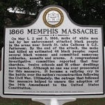 An historical marker tells the story of the Memphis Massacre, one of the city''s darkest episodes.