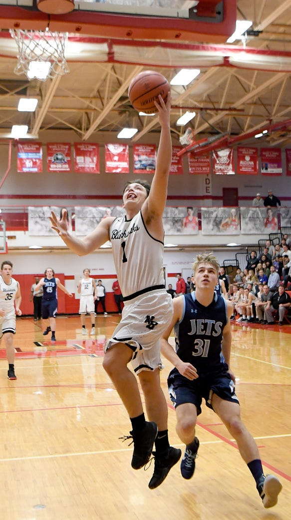 North Buncombe's Jt Laws goes up for a shot ahead of