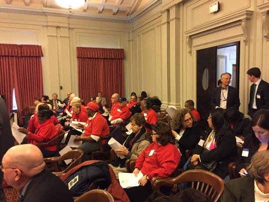 AARP members and others crowd the Board of Public Utilities meeting room in Trenton, seeking a cut in JCP&L's rates.