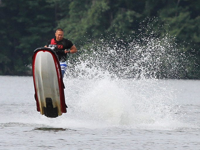 A thrill-seeker on a personal watercraft gets some air as he enjoys a summer afternoon on Lake Mahopac July 19, 2014.