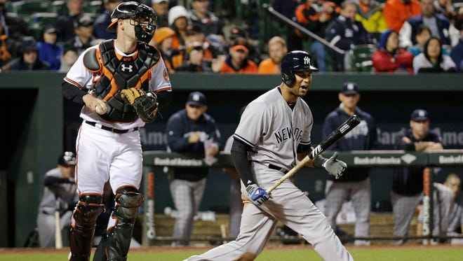 New York Yankees' Aaron Hicks, right, reacts after striking out in front of Baltimore Orioles catcher Matt Wieters in the eighth inning of a baseball game in Baltimore, Thursday, May 5, 2016. Baltimore won 1-0 in ten innings.