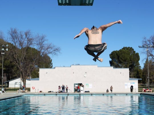 Ian Stripling of Redding competes in the splash contest during the 2016 Polar Bear Plunge at the Redding Aquatic Center.