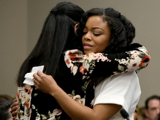Tiffany Thomas Lopez, a former Michigan State softball player who was abused by Larry Nassar, gets a hug from Gina Nichols after testifying in January 2018 during Nassar's sentencing hearing in Ingham County Court. Lopez said she told two MSU athletic trainers, Lianna Hadden and Destiny Teachnor-Hauk, that Nassar digitally penetrated her during treatment for lower back pain.