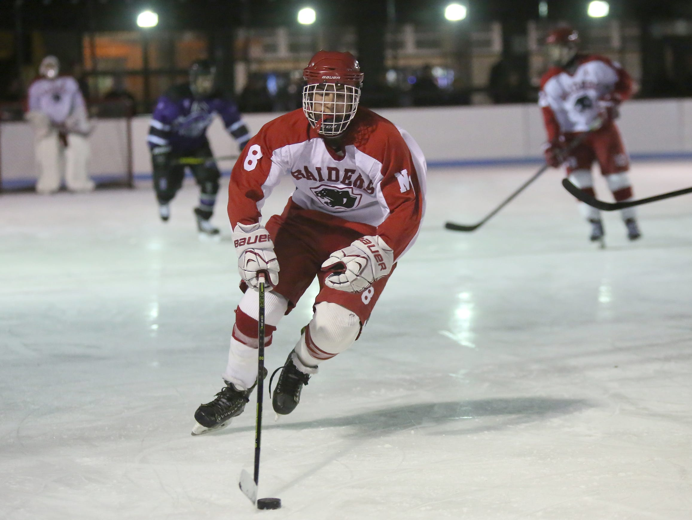 North Rockland's Justin Morina (8) skates the puck across the blue line during the first annual Winter Classic Hockey Tournament against Monroe-Woodbury at the Bear Mountain Ice Rink in Tompkins Cove on Friday, Dec. 18, 2015.