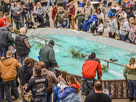Trout ponds at fishing expos always draw anglers of