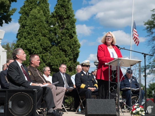 Deborah Owens, Battle Creek City Commissioner speaks during the 911 Remembrance ceremony at McCamlyPark on Sunday.