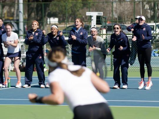 The Auburn women tennis team celebrates with Auburn's