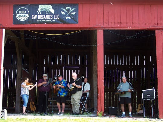 With the barn at Grassway Organics Farm serving as the stage and background, the Red Star Express band entertained the crowd at a pizza on the farm evening.