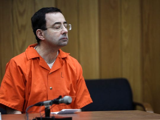 Larry Nassar listens as lead prosecutor Angela Povilaitis