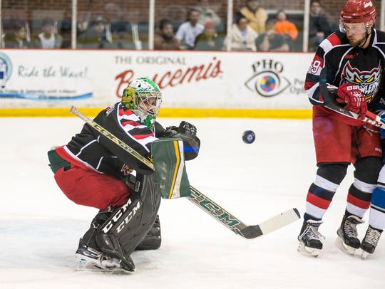 Port Huron Prowlers goalie Michael Santaguida blocks