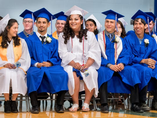Graduating seniors enjoy a lighter moment during the commencement address.