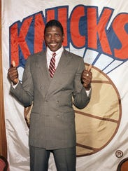 Knicks' Patrick Ewing making the thumbs-up sign during