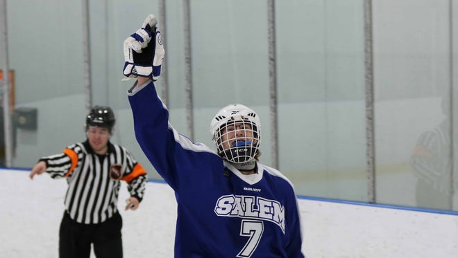 Salem junior forward Jake Saunders celebrates after scoring one of his three goals Saturday against Grandville.