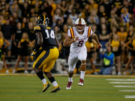 Iowa State receiver Allen Lazard, right, runs a play