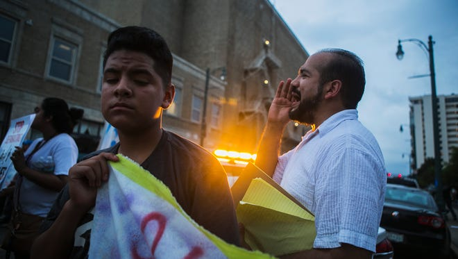 July 28, 2017 - Marcos Villa, community outreach coordinator for Latino Memphis, yells a chant to a crowd of advocates and supporters while they stand at the intersection of South Main St. and Beale St. during an immigrant candlelight vigil from Martyrs Park to Beale Street on Friday evening. The event was held to denounce the recent arrests in Memphis of Hispanics from the United States Immigration and Customs Enforcement (ICE) and to support the immigrant community.
