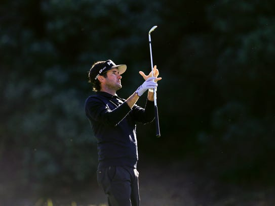 Bubba Watson watches his second shot on the 13th hole