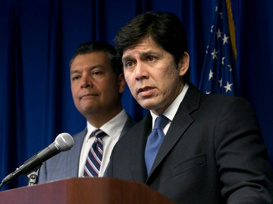 FILE -- In this Sept. 5, 2017 file photo, State Senate President Pro Tem Kevin de Leon, D-Los Angeles, right, flanked by Secretary of State Alex Padilla, answers questions at a news conference in Sacramento, Calif. California Gov. Jerry Brown signed de Leon's SB54, the statuary state bill, that extends protections statewide for immigrants living the United State illegally, Thursday, Oct. 5, 2017.