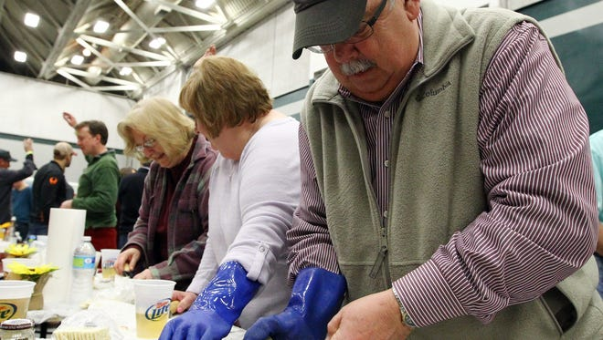 Rick Wentzky shucks oysters at the Civic Center of Anderson during the St. George Episcopal Church Charity Oyster Roast.