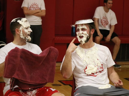 Marcus Rimboch, left, and Lucas Kennedy, organizers of the 'Ball for Lipstraw' charity event,  took pies to the face after the middle school staff won over the high school.