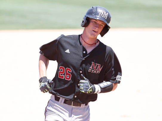 New Mexico State catcher Jason Bush trots home after